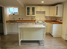 Basement apartment from 4men1lady! They used our white subway tile in their kitchen and bath.