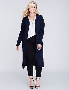 Dramatic length and subtle allover sparkle make this ribbed sweater a top layering choice. Vented hem. Contrasting trim at sleeves and hem.  lanebryant.com