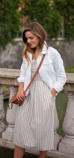 Throw on a white denim jacket over a gorgeous sundress this spring! A great extra layer for dressing down or for a cool evening!