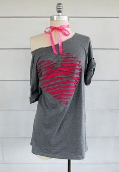Cute idea to jazz up a boring tee by cutting strips in a pattern (here a heart) and then sewing a contrasting color of fabric underneath.
