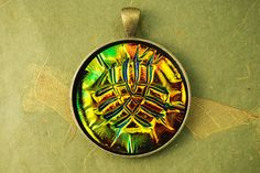 Bronze Age Holographic pendant in polymer clay by The Blue Bottle Tree