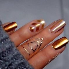 If you want to feel a touch of luxury, add some gold to your nail art.