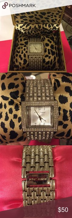 Hersey Johnson silver sparkle watch Betsey Johnson silver watch.  The watch has been GENTLY worn, and has a few minor scratches. It needs a new battery. Watch comes with original box, cushion, and user manual. Original tag retails $150. Betsey Johnson Accessories Watches