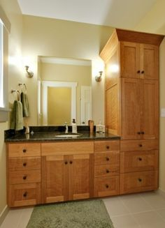 Like the color of stain and counter top cabinets/hardware.  Would work nicely for a guest bathroom remodel!