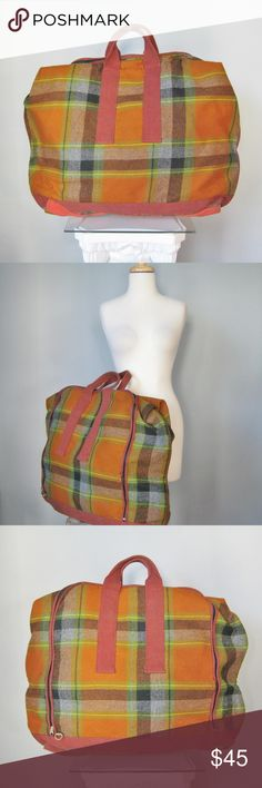 """Vintage Plaid Wool Soft Suitcase for Guys or Gals Fabulous Plaid wool soft suitcase or carryall from the 1950s. Zipper closure,  webbing trim & handles Light colored fabric interior with straps to hold garments in place. So mid century cool for a guy or gal. Made in the USA by Atlantic Products Corp  Pillow Pak brand Clean inside and out, no moth damage, Damage to about an inch of the zipper edge trim.  (Doesn't affect function) One of the interior straps is missing a metal clip 27"""" x 20"""" x…"""
