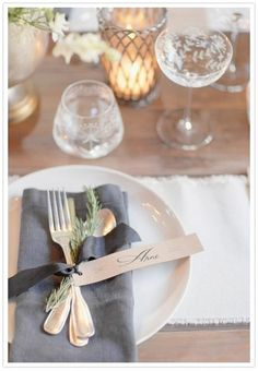 Can be done with baby's breath and the guests name attached to the silverware.