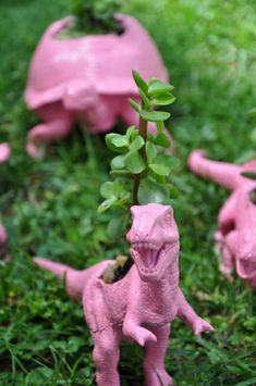 Finally, something to do with the 639 dinos around our house -- planters! Recycled Toys - Planters via lilblueboo.com