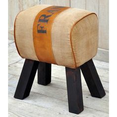 HAND MADE FRANCE SADDLE STOOL  Created from repurposed army tent canvas, this beautiful saddle stool emanates a vintage characteristic that is highly unique. This comfortable cushion top is perfect day to day use.