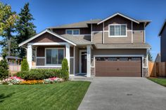 The ABERCROMBIE home as seen at Brink Ranch in #Spanaway! Love the #frontporch and landscaped yard.