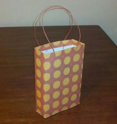 Make a tall slender gift bag using 1 sheet of scrapbook paper