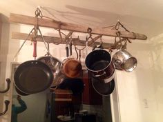 Pot rack from old ladder.  Old meat and hay hooks
