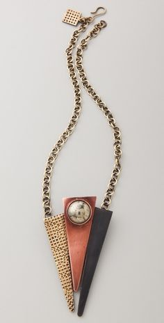 "Kelly Wearstler: Abstract Patina Necklace  ""This antiqued brass chain necklace features a mirrored ball detail at the mixed-metal pendant. Hook-and-eye clasp."""
