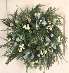 This farmhouse greenery wreath is constructed on a grapevine wreath base. With all of the beautiful greenery.fern, rosemary, lambs ear and eucalyptus and a touch of queen anne's lace. This door wreath will compliment any decor.