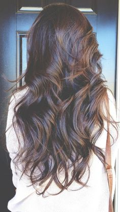 Figure 8 curls Tools: curling iron and clippies Products: pure abundance style prep Phomollient Control force hairspray