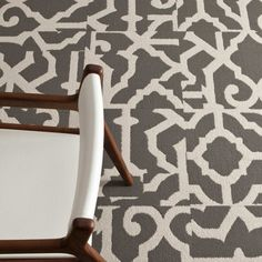 Go bold in never-out-of-style black and white. This fanciful grillwork pattern in a durable loop pile construction has lasting grateness written all over it. Looks best with squares installed straight or parquet style. Made in the USA. This is a random pattern and no two tiles are alike. The pattern will not align.