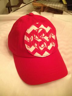 Red hat with monogrammed patch