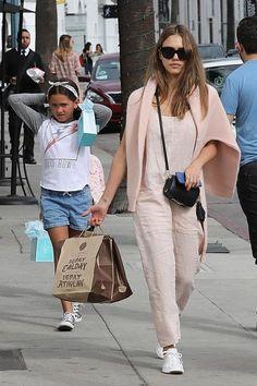 Jessica Alba wearing Ullu Iphone Snap-on Case in Blue Steel, Pop & Suki Luggage Tag, Pop & Suki Short Tassel and Pop & Suki Camera Bag
