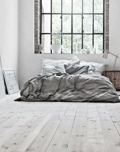 Big industrial windows in the bedroom/ Soft grey linens