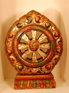 Hand painted and gold leafed pine wood Dharma wheel from Tibet, China