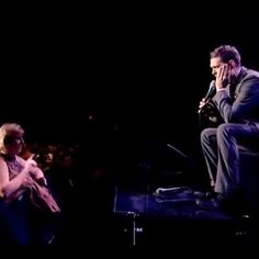 A fan at a Michael Buble concert harasses the singer and he invites her son to come on stage and sing with him. What happens next blows everyone away...
