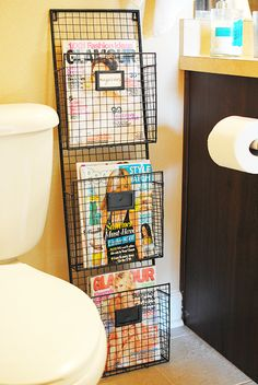 Lauren Elizabeth: 7 WAYS TO GLAM UP YOUR BATHROOM - I like this for magazines in the bathroom as opposed to on the wall for mail, etc.