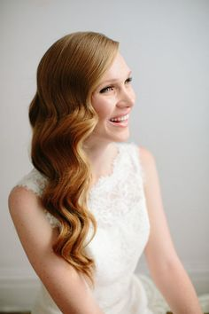 Glam waves pinned back with an accessory give a nod to retro-chic. For a more half-up look, pull one side of your hair over to about the middle of the nape of your neck and pin in place.  Read more: http://stylecaster.com/beauty/wedding-hairstyles-half-up/#ixzz4CxXwLIO8