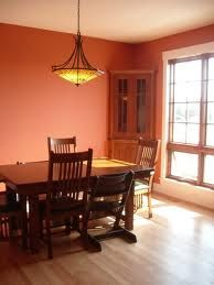 softer than red or orange, we love this terra cotta room paint