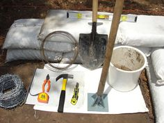 Earthbag Building Tools.  To improve strength, barbed wire is often placed between courses & rebar can be hammered in to strengthen corners & openings.  The bags are sometimes tied together with twine to give temporary strength during construction.
