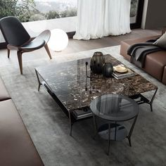 Planet round table with black nickel structure, grey transparent top, perimetral frame with silver finish. Squared coffee table with black nickel structure, emperador marble top Deco Furniture, Luxury Furniture, Furniture Design, Contemporary Furniture, Coffe Table, Coffee Table Design, Oval Table, Dining Table, Diy Décoration