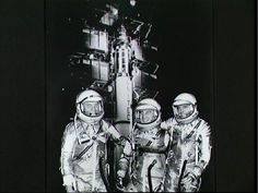 Space suited project Mercury astronauts John H. Glenn, Virgil I. Grissom, and Alan B. Shepard Jr. (left to right) are posing in front of a Redstone rocket in this vintage 1961 NASA publicity photo.