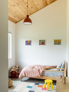 In the second bedroom, an IKEA bed and West Elm rug bring a sense of playfulness, complemented by a pendant light from Muuto. #dwell #modernfarmhouse #northcarolina #interiordesign #moderndesign #kidsroom West Elm Rug, Indoor Outdoor Living, Chalet Design, Ikea Bed, Two Bedroom, Bedrooms, New Room, House Rooms, My Dream Home