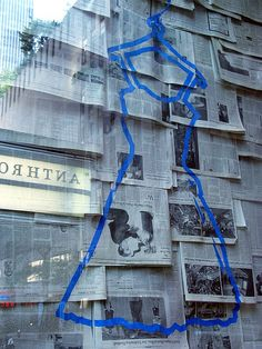 Anthropologie - Store Windows ~ easy, cheap, & impactful— just with a painted frame instead - Visual Merchandising, Vintage Shop Display, Store Window Displays, Paper Store, Shop Fronts, Store Windows, Book Projects, Retail Design, Store Design