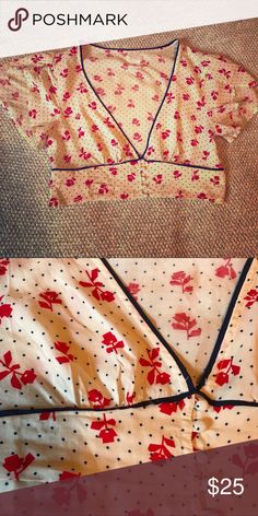 2436c76a71585 Retro Cropped Blouse Cream with navy blue polka dots and red rose pattern.  Material is soft and Delicate with cute buttons in front.