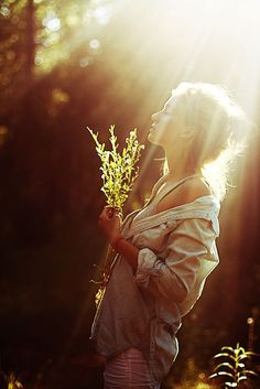 A woman at one with nature and light.