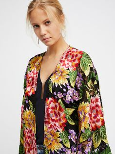 Embroidered Lace Kimono | Delicate sheer lace kimono featuring bold and bright allover floral embroidery detailing.    * Open front   * Wide sleeves   * Adjustable waist belt
