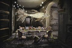 The mighty Koi hangs in splendor over a fabled dining scene that is strewn with the remnants of a magnificent feast. http://www.ylighting.com/blog/lzf-lamps-life-size-dreams/