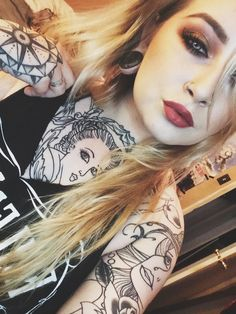 So Pretty. :) Tattoos are awesome and you know we love large stretched lobes!  www.karmase7en.com The Buy One Choose One Free Body Jewellery Shop