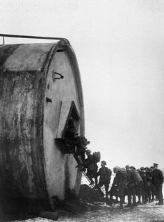 Soldiers find unusual lodging for the night in a large concrete tank near Riencourt, France, 1918.
