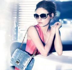 Mila for Dior. I love the bag. And how you can still see her eyes through the sunglasses!