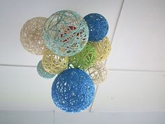Paper mache lanterns made with balloons and yarn.  Just did 3 of these.  Forgot to grease/oil the balloons.  Says that's not good.  Messy/time consuming but I want these!!!!