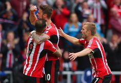Connor Wickham of Sunderland (C) celebrates scoring the opening goal with Steven Fletcher (L) and Sebastian Larsson of Sunderland during the Barclays Premier League match between Sunderland and Stoke City at Stadium of Light on October 4, 2014 in Sunderland, England.