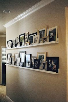 Pinterest got me once again...    I was seeing pins all over my feed of beautiful picture ledges.  I had a large blank wall going down my...