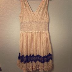 Fit & Flare Free People Dress Gorgeous sparkly festive free people dress. This dress fit me when I was a size 6 and when I was a 12. It's very stretchy and super comfortable! Color is pale pink/beige with a silver pattern and band of black lace in the skirt. Skirt flares so you can twirl in it  very good used condition, worn a few times per year for the last few years. Free People Dresses