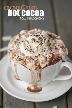 Rich and decadent Coconut Rum Hot Cocoa made from milk, half and half, chocolate, and coconut rum will warm your belly and put a smile on your face!