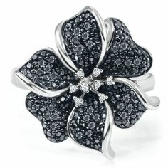 I love this ring!  Sterling Silver 1/4ct TW Round Black & White Diamond Flower Ring.