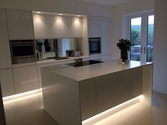 Modern white kitchen with gloss handle less doors