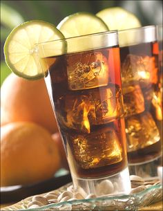 Cuba Libre - Fill a highball glass with ice. Pour in 2 ounces light rum, 1 tablespoon of freshly-squeezed lime juice and 2 dashes of bitters. Fill the glass with cola and stir. Garnish with a lime slice.