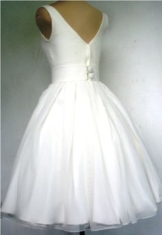 A beautiful ivory wedding dress with a boat by elegance50s on Etsy