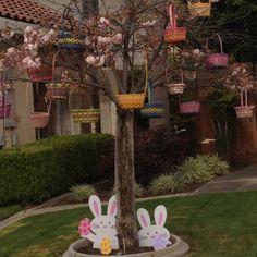 Easter Tree....baskets instead of eggs...in tulip tree...great idea!