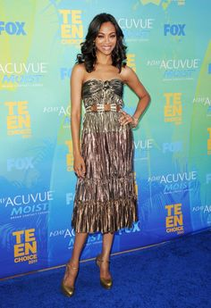 Pin for Later: 113 Reasons Why Zoe Saldana's Style Is Out of This World  Zoe sparkled (literally) in a metallic gold Lanvin dress and Alexander McQueen pumps at the 2011 Teen Choice Awards.